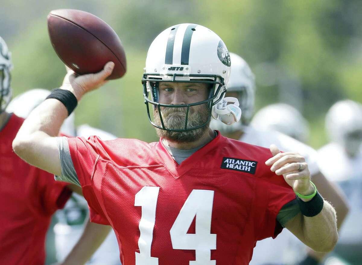 New York Jets quarterback Ryan Fitzpatrick throws a pass during NFL football training camp.