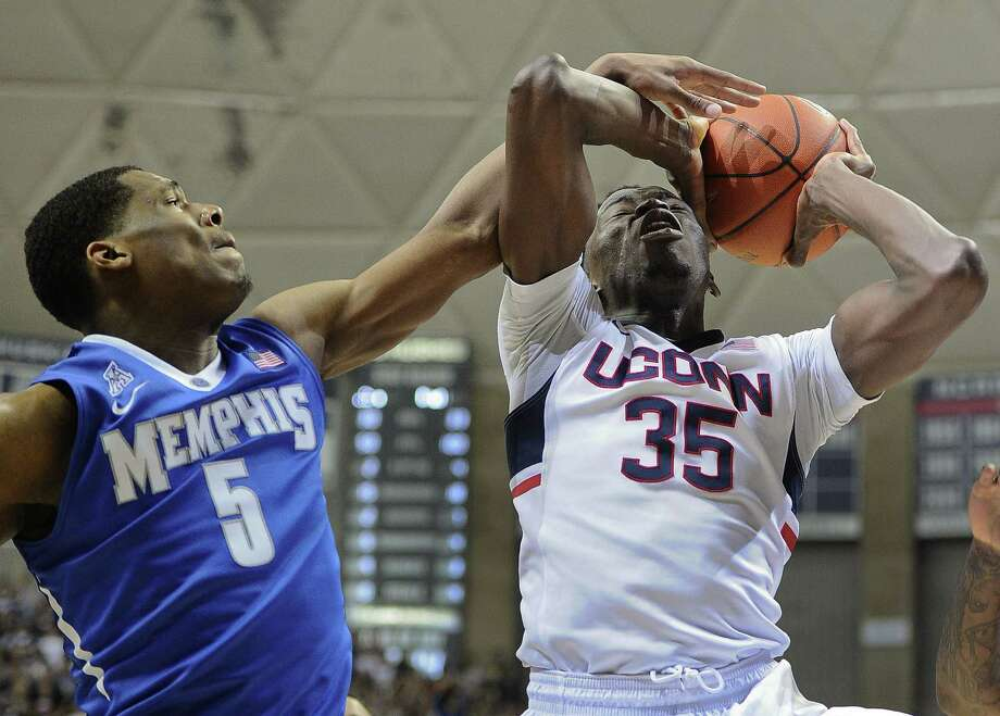 UConn's Amida Brimah, right, was named the American Athletic Conference Defensive Player of the Year on Wednesday. Photo: Jessica Hill — The Associated Press  / FR125654 AP