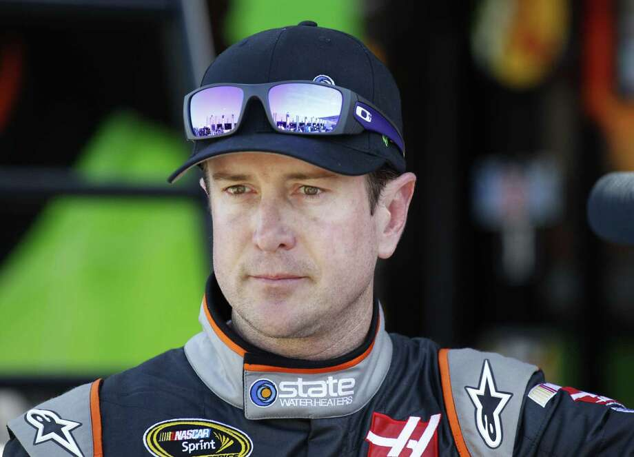 NASCAR lifted its suspension of Kurt Busch on Wednesday and ruled the former champion can compete in the title Chase should he qualify. Busch missed the first three races of the season when NASCAR suspended him for an alleged domestic assault on his ex-girlfriend. Photo: Terry Renna — The Associated Press File Photo  / FR60642 AP
