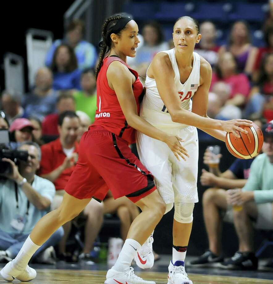 United States' Diana Taurasi keeps the ball from Canada's Nayo Raincock-Ekunwe during the first half of an exhibition basketball game Friday in Bridgeport. Photo: Jessica Hill — The Associated Press  / AP2016