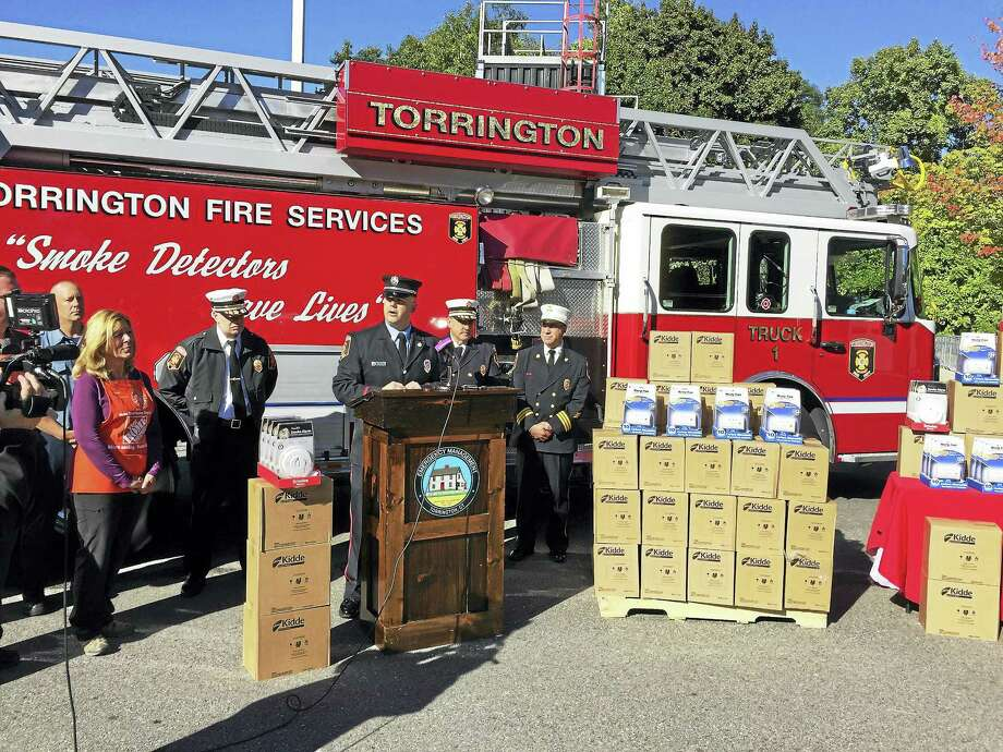 Ben Lambert - The Register Citizen  Torrington firefighters launched a drive to equip city homes with free smoke and carbon dioxide detectors Thursday morning. Above, Chief Gary Brunoli speaks during the kickoff event. Photo: Journal Register Co.