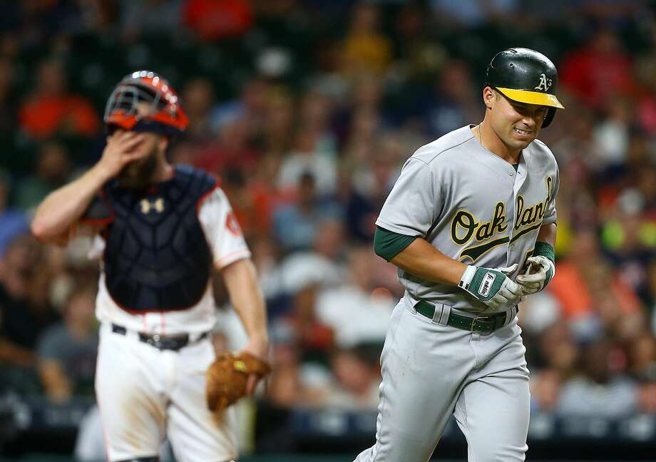Oakland Athletics center fielder Jake Smolinski (5) goes to first after being hit by a pitch during the fifth inning of an MLB game at Minute Maid Park, Monday, Aug. 29, 2016, in Houston.  ( Jon Shapley / Houston Chronicle ) Photo: Jon Shapley, Houston Chronicle