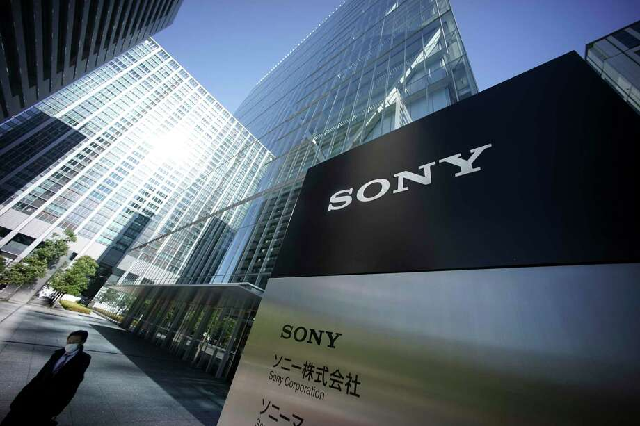 In this Dec. 18, 2014, file photo, a man walks out from the headquarters of Sony Corp. in Tokyo. Improving cybersecurity practices has emerged as a top national priority for Japan, stung in recent years by embarrassing leaks at Sony Pictures, the national pension fund and its biggest defense contractor, Mitsubishi Heavy Industries. Photo: AP Photo/Eugene Hoshiko   / AP