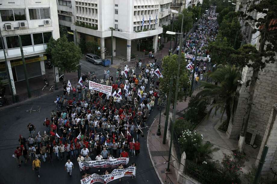 Members of the Communist-affiliated PAME labor union march during an anti-austerity rally in Athens Wednesday. Greece has a tentative rescue deal, but relief that it is not falling out of the euro is unlikely to last long: its economy has taken a huge hit. Photo: AP Photo  / AP