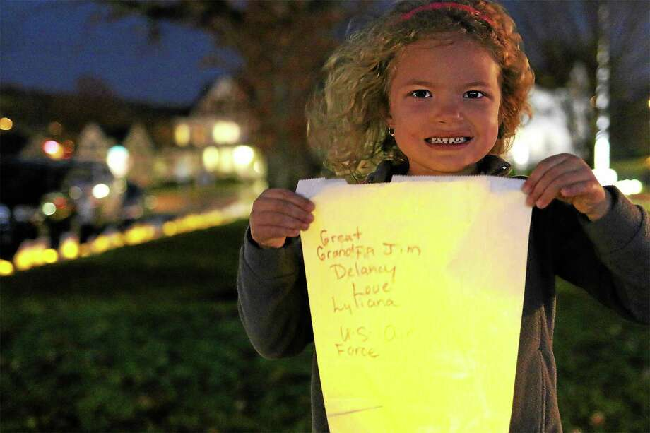 Lyliana Martinez, 5, hold the luminary bag she made for her great grandpa Jim Delancy, who is commander of the Andrew B. Mygatt VFW Post 1672. Photo: John Fitts — The Register Citizen