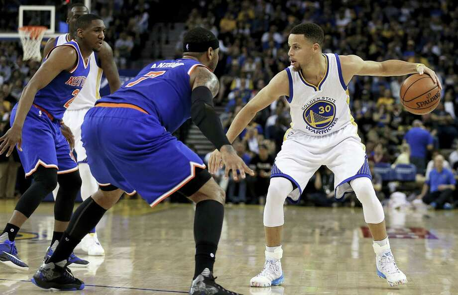 Golden State Warriors' Stephen Curry, right, is defended by New York Knicks' Langston Galloway, left, and Carmelo Anthony (7) during the second half of an NBA basketball game Wednesday, March 16, 2016, in Oakland, Calif. (AP Photo/Ben Margot) Photo: AP / Copyright 2016 The Associated Press. All rights reserved. This material may not be published, broadcast, rewritten or redistributed without permission.