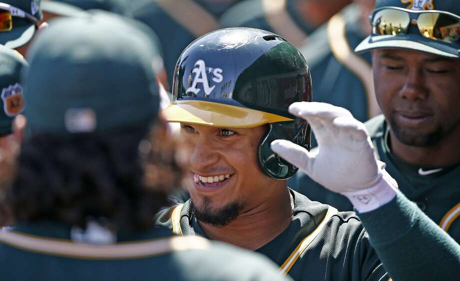 Oakland Athletics shortstop Franklin Barreto celebrates his home run against the Cleveland Indians during the first inning of a spring training baseball game against the Oakland Athletics Thursday, March 16, 2017, in Goodyear, Ariz. The Indians defeated the Athletics 6-5. (AP Photo/Ross D. Franklin) Photo: Ross D. Franklin, AP
