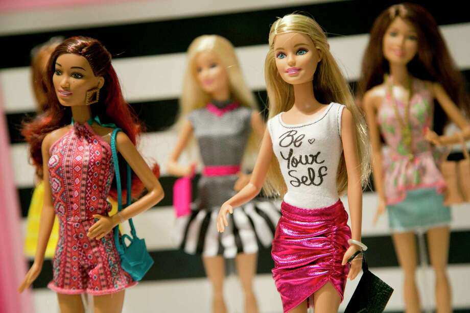 """In this Sept. 29, 2015, photo, Barbie Fashionista Dolls from Mattel are displayed at the TTPM Holiday Showcase in New York. The U.S. toy industry is expected to have its strongest year in over a decade. Richard Dickson, Mattel's president and chief operating officer, told investors that he's seeing """"a lot of positive momentum"""" coming from its two biggest brands — Barbie and Fisher-Price. Photo: AP Photo/Mark Lennihan   / AP"""