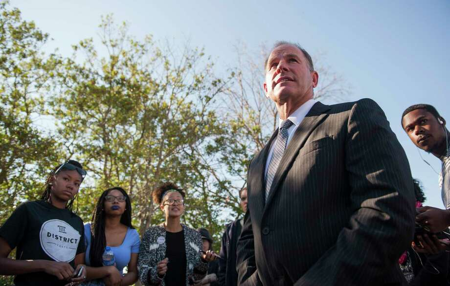 In a Nov. 3, 2015 photo, University of Missouri President Tim Wolfe speaks with members of Concerned Student 1950 senior Abigail Hollis, from left, senior DeShaunya Ware and junior Shelbey Parnell as they call for Wolfe's resignation outside University Hall on the University of Missouri campus, in Columbia, Mo. Wolfe resigned Monday, Nov. 9, 2015 amid criticism of his handling of racial issues. Photo: Daniel Brenner/Columbia Daily Tribune Via AP  / Columbia Daily Tribune