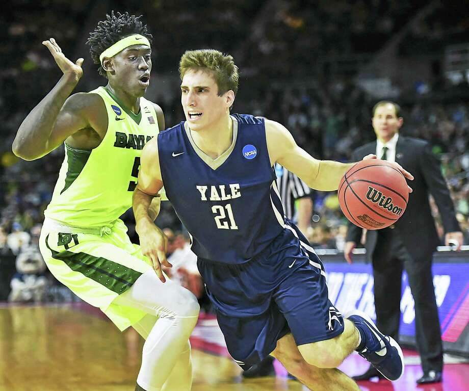 Yale's Nick Victor drives to the paint as Baylor's Jonathan Motley defends in a 79 -75 win for the Bulldogs in the first round of the 2016 NCAA Men's Basketball Tournament at the Dunkin' Donuts Center in Providence, R.I. Yale will play Duke in the second round Saturday. Photo: Catherine Avalone — New Haven Register / New Haven RegisterThe Middletown Press