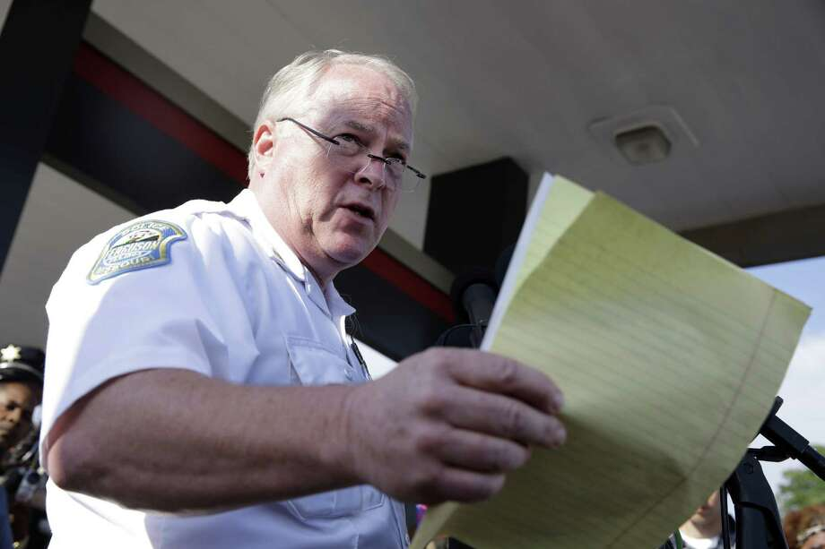 FILE - In this Aug. 15, 2014 file photo, Ferguson Police Chief Thomas Jackson releases the name of the the officer accused of fatally shooting Michael Brown in Ferguson, Mo. On Friday, March 6, 2015, Jackson is still on the job, two days after a government report criticized his department for years of racial profiling. Photo: (AP Photo/Jeff Roberson) / AP