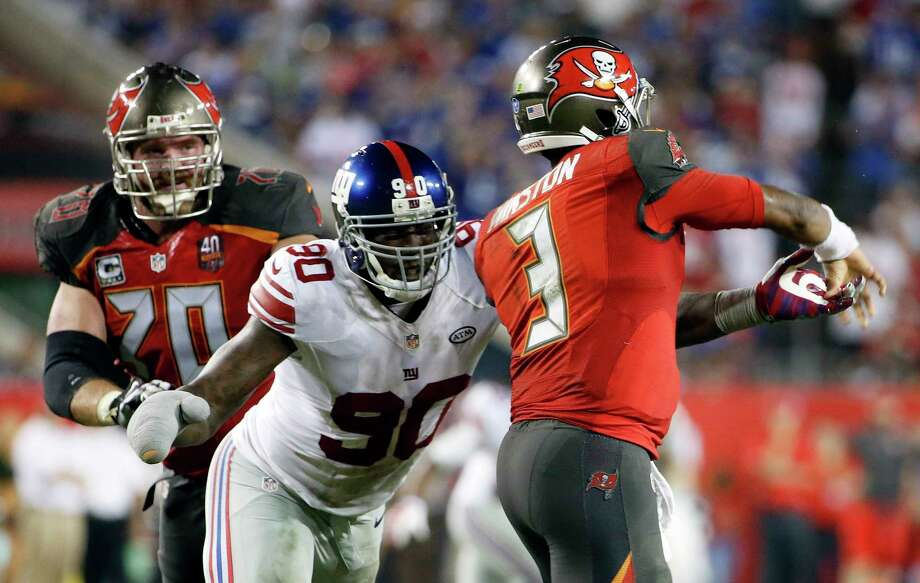 Giants defensive end Jason Pierre-Paul (90) hits Buccaneers quarterback Jameis Winston during Sunday's game. Photo: Brian Blanco — The Associated Press  / FR170107 AP