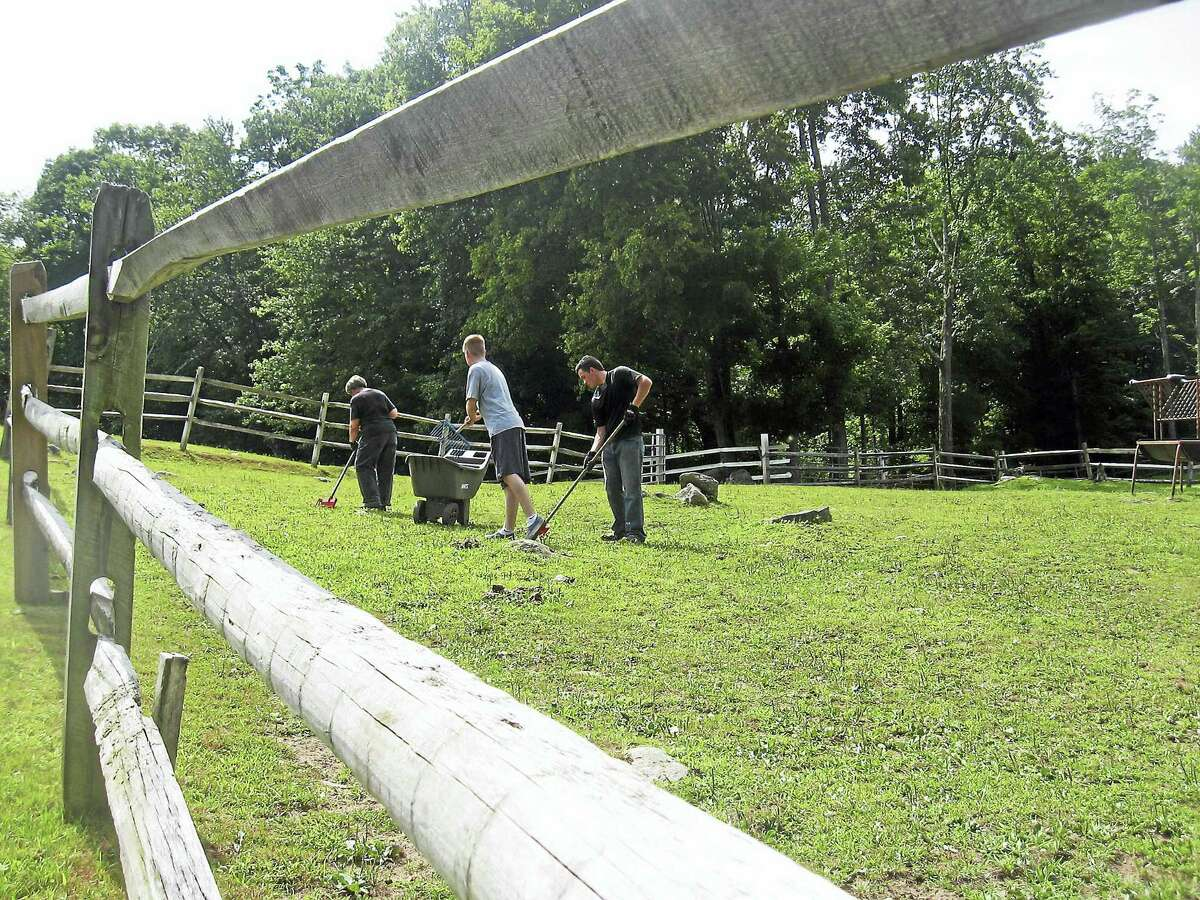 Volunteers help clean up the fields for H.O.R.S.E. of Connecticut.