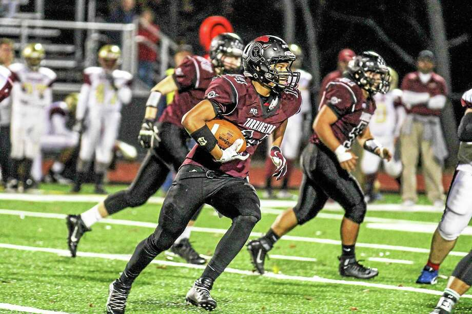 Torrington's Newton Frias makes an 18 yard gain in his team's win over Sacred Heart-Kaynor Tech Friday night. Photo: Marianne Killackey – Special To Register Citizen  / 2015