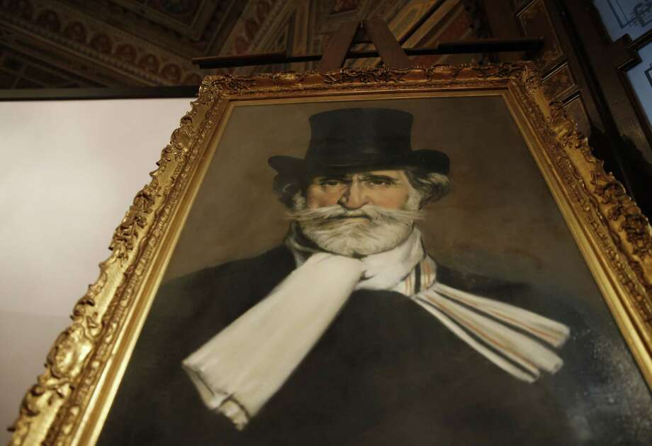 A painting showing the Italian composer Giuseppe Verdi is displayed at the Casa Verdi, in Milan, Italy, Wednesday, July 15, 2015. A home for retired musicians created by composer Giuseppe Verdi has secured of a cache of intimate, joking and sometimes off-color correspondence with an Italian count for the bargain price of 120,000 euros ($132,000). (AP Photo/Luca Bruno) Photo: AP / AP
