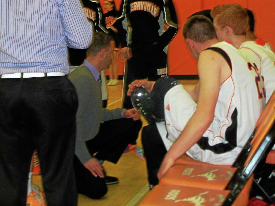 Terryville coach Mark Fowler talks strategy for the Kangaroos' 58-37 win over Portland Tuesday night in a first-round Class S game at Terryville High School. Photo: Peter Wallace — Register Citizen