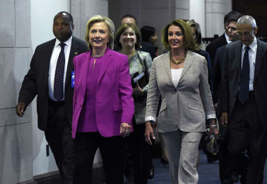 Democratic presidential candidate Hillary Rodham Clinton walks with House Minority Leader Nancy Pelosi of Calif. on Capitol Hill in Washington, Tuesday, July 14, 2015. Clinton is attend meetings on Capitol Hill with House and Senate Democrats. (AP Photo/Susan Walsh) Photo: AP / AP