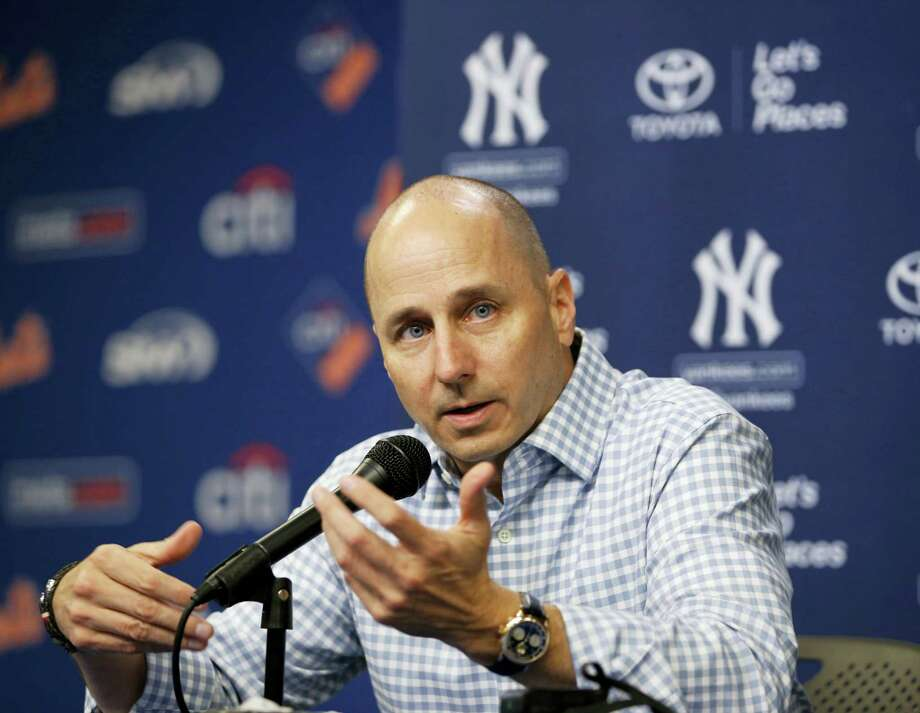In this Aug. 1 file photo, New York Yankees general manager Brian Cashman speaks to the media before an interleague baseball game against the New York Mets. Cashman prefers to give the team's prospects a chance at first base and right field next season rather than try for upgrades in the trade or free-agent markets. Photo: ASSOCIATED PRESS FILE PHOTO  / Copyright 2016 The Associated Press. All rights reserved. This material may not be published, broadcast, rewritten or redistribu