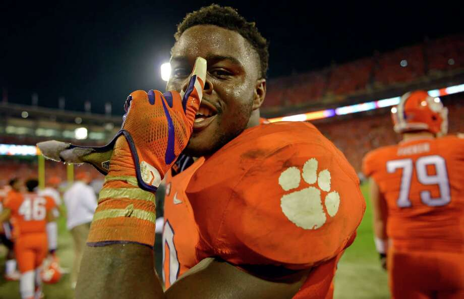 Clemson's Shaq Lawson celebrates in the closing minutes of their 23-13 win over Florida State on Saturday. Photo: The Associated Press  / FR159523 AP