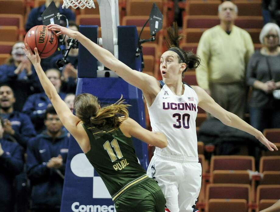 Connecticut's Breanna Stewart blocks a shot attempt by South Florida's Ariadna Pujol, left, during the first half of an NCAA college basketball game in the American Athletic Conference tournament finals at Mohegan Sun Arena, Monday, March 7, 2016, in Uncasville, Conn. (AP Photo/Jessica Hill) Photo: AP / FR125654 AP