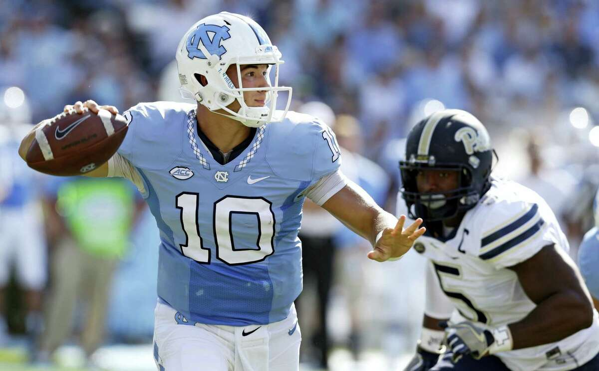 In this Sept. 24, 2016 photo, North Carolina quarterback Mitch Trubisky (10) throws a pass as Pittsburgh's Ejuan Price (5) rushes during the first half of an NCAA college football game in Chapel Hill, N.C. UNC's takes on Florida State in an ACC matchup on Saturday.