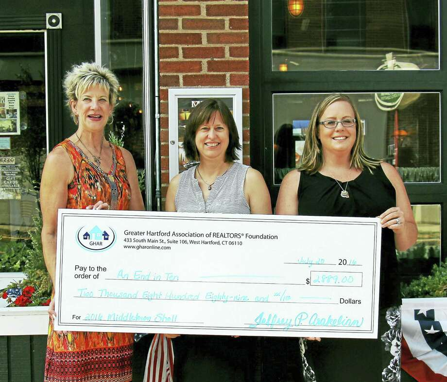 Contributed  photo From left are Mary Beth Bain, event sponsor; Ann Foust of MCCHH; and Kaethe Everett, Committee Chair), at the GHAR fundraiser. Photo: Journal Register Co.