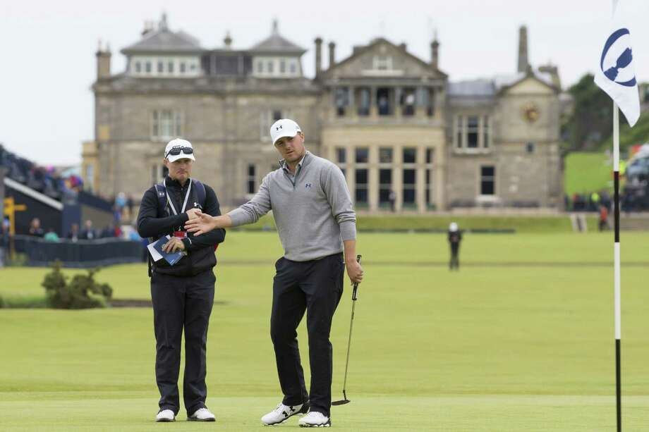 With the clubhouse in the background Jordan Spieth reacts after playing a shot on the first green during a practice round at St Andrews Golf Club on Monday. Photo: Jon Super — The Associated Press  / AP