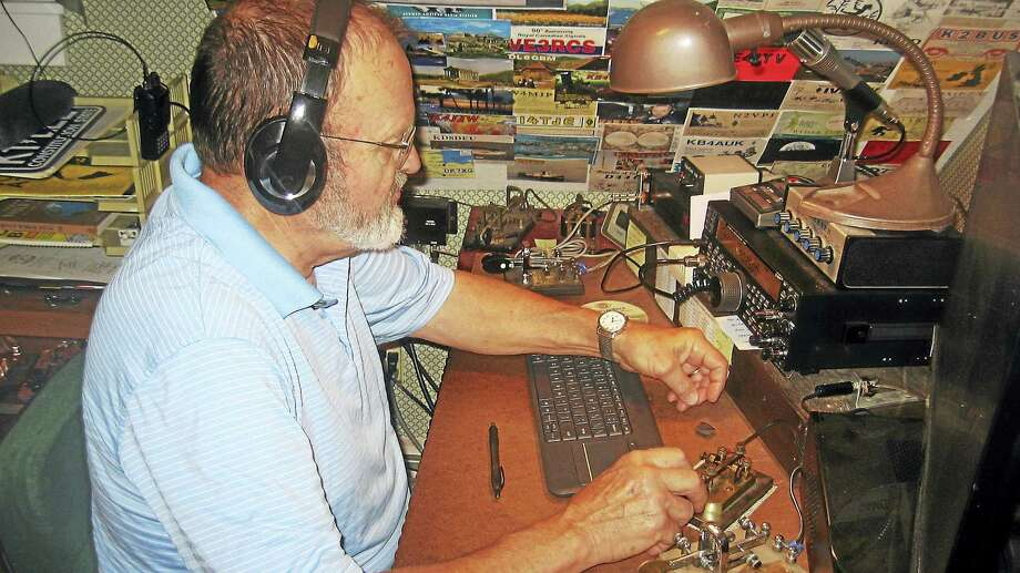 Photos by John Torsiello Lee Collins at his ham radio. Photo: Journal Register Co.