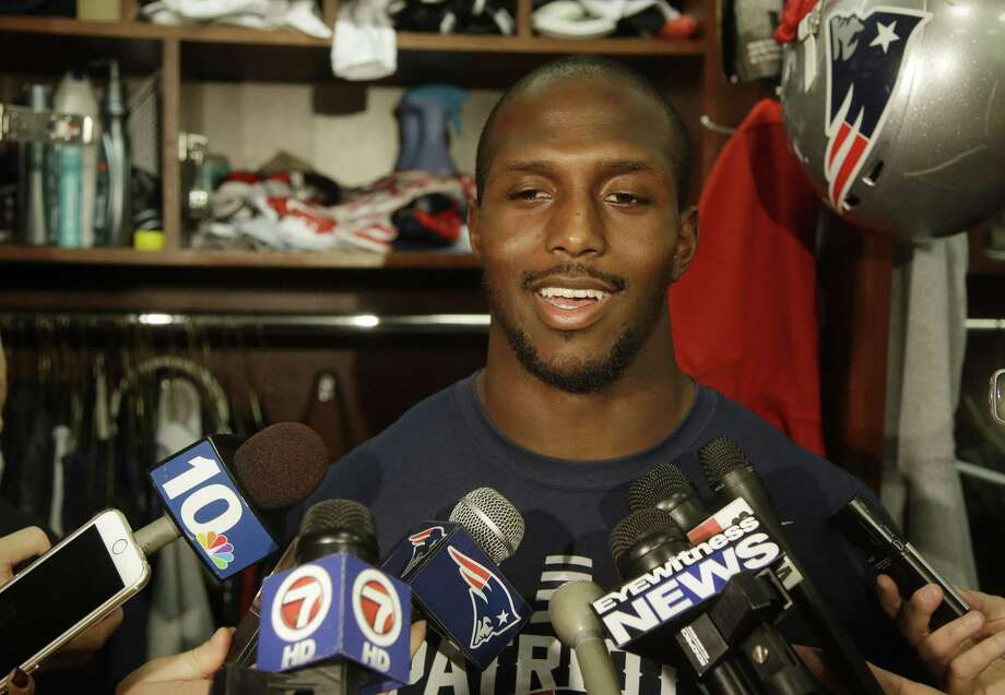 New England Patriots free safety Devin McCourty says he's returning. Photo: Stephan Savoia — The Associated Press File Photo  / AP