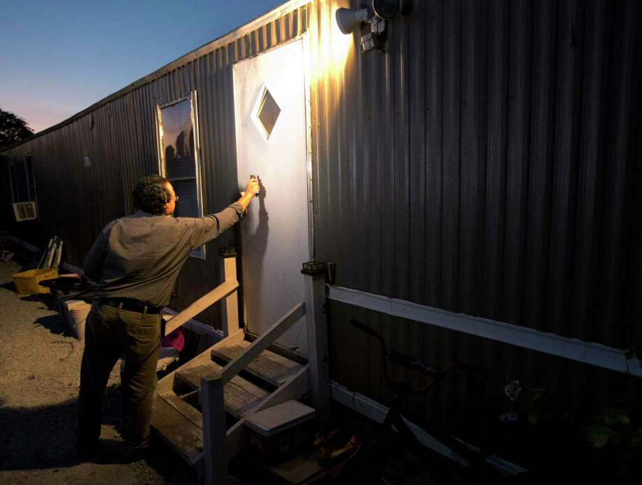 In this Thursday, Nov. 12, 2015, photo, Antonio Tovar-Aguilar, an investigator with the Florida Department of Health, knocks on a farmworker's door during a follow-up visit in Belle Glade, Fla. Farmworkers are supposed to be protected by government rules regulating exposure to toxic pesticides and herbicides. But an Associated Press review of federal and state enforcement data and other records showed that the system is riddled with problems. Photo: AP Photo/Wilfredo Lee   / AP