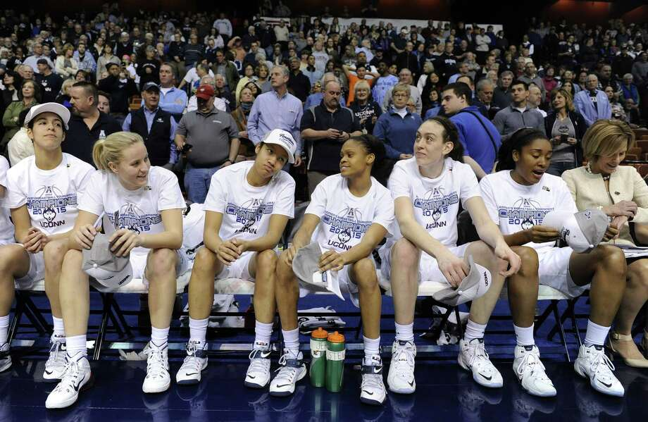 UConn celebrates after the Huskies' 84-70 win in the final of the American Athletic Conference tournament on Monday in Uncasville. Photo: Fred Beckham — The Associated Press  / FR153656 AP