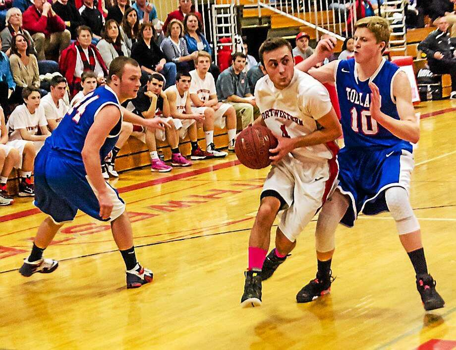 Submitted photo Northwestern's Zach Tuxbury drives to the basket for two points. Photo: Journal Register Co.