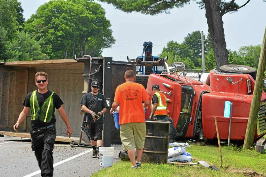 A dump truck rollover caused a portion of Route 202 in Litchfield to close Monday. Photo: Amanda Webster — The Register Citizen