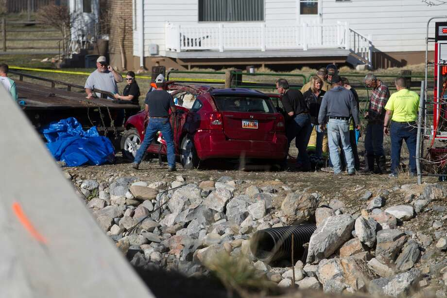 In this March 7, 2015 photo, officials respond to a report of car in the Spanish Fork River in Spanish Fork, Utah. Photo: AP Photo/The Daily Herald, Sammy Jo Hester  / The Daily Herald