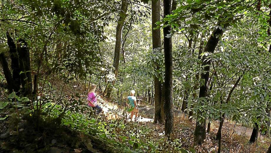 In this Aug. 1, 2012 photo, two women walk from the town of Harpers Ferry, W.Va., onto the Appalachian Trail. Photo: AP Photo/Vicki Smith  / AP2012