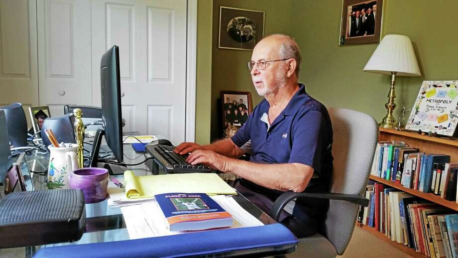 Goshen author Frank Strauss, 80, is pictured at his home office. Photo: Photo By N.F. Ambery