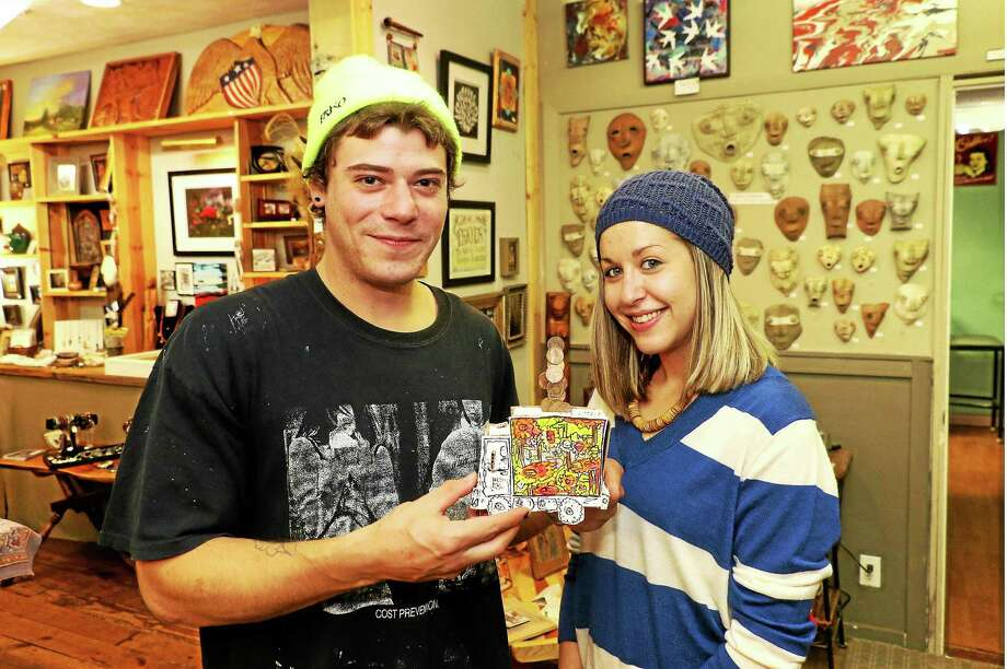 """Jeff Martin of Terryville shows off his """"Piggy Bank Box Truck"""" that he entered into the show. With him is Jillian Philbrick. Photo: John Fitts — The Register Citizen"""