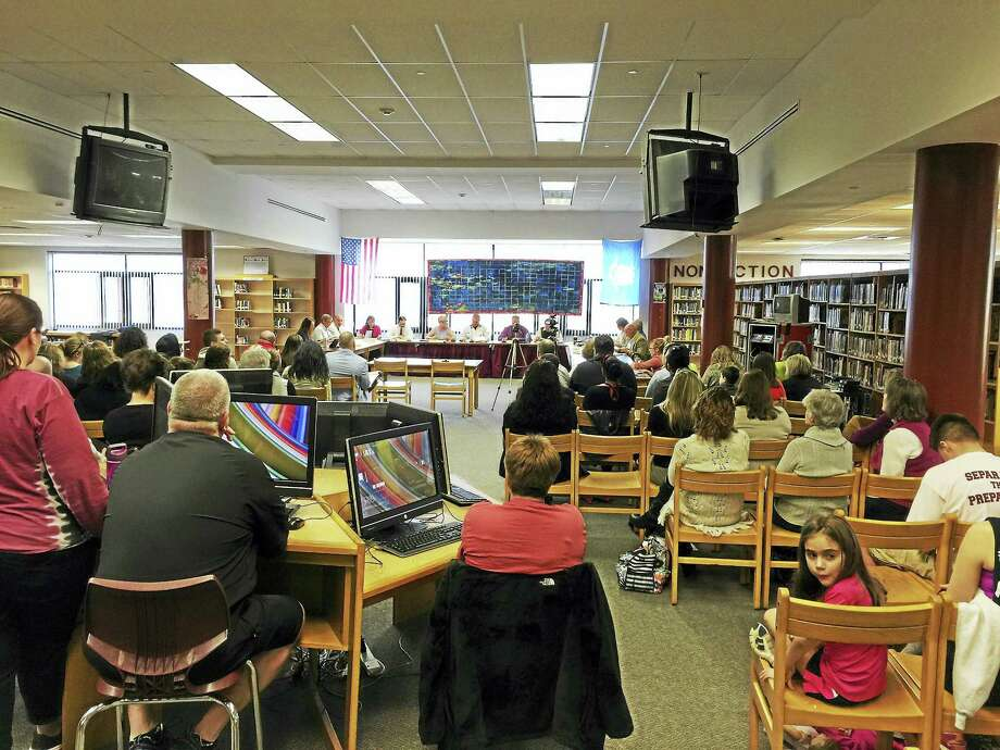 Residents packed the Torrington High School Media Center Wednesday as the Board of Education discussed how to addressed a budget deficit. Photo: BEN LAMBERT — REGISTER CITIZEN