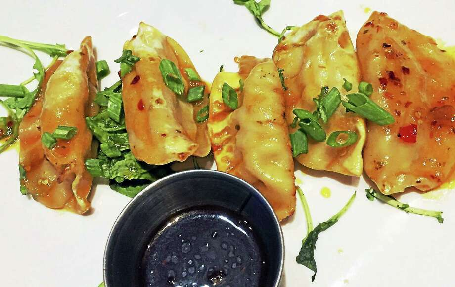 Ginger chicken potstickers with dippy sauce at Tom's Urban at Mohegan Sun. Photo: Joe Amarante — Register