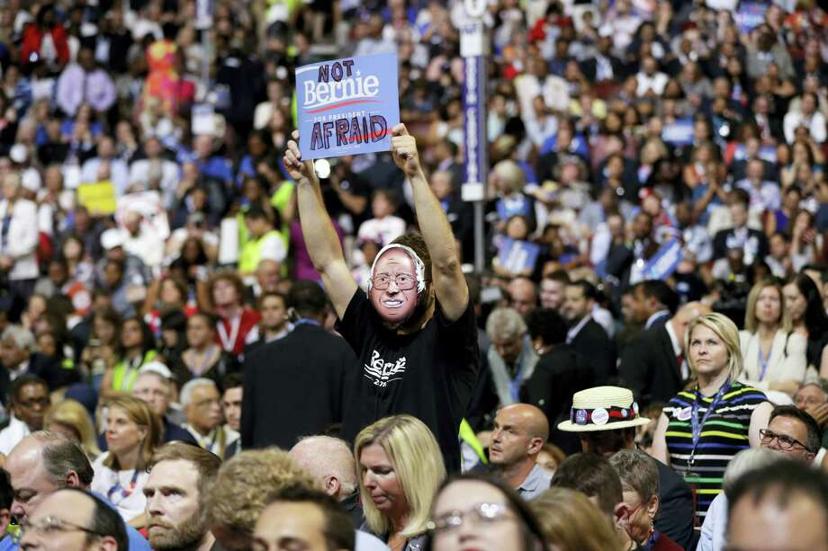 Supporter for former Democratic presidential candidate, Sen. Bernie Sanders, I-Vt., holds up a sign as President Barack Obama speaks during the third day session of the Democratic National Convention in Philadelphia, Wednesday, July 27, 2016. Photo: AP Photo/Matt Rourke   / Copyright 2016 The Associated Press. All rights reserved. This material may not be published, broadcast, rewritten or redistribu