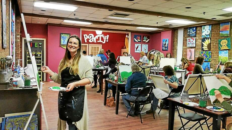 "Torrington artist Carrie Taylor leads a ""Cocktails & Canvases"" fundraising party at The Arts Desire at 97 Main St. in Torrington on Sunday evening. Photo: N.F. Ambery — Special To The Register Citizen"