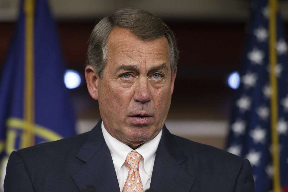 Speaker of the House John Boehner, R-Ohio, speaks with reporters on Capitol Hill in Washington on July 9. Photo: AP Photo  / FR170079 AP