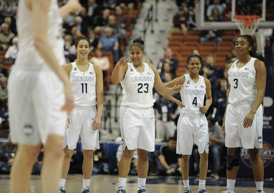 UConn's Kaleena Mosqueda-Lewis (23), points to teammate Breanna Stewart, as teammates Kia Nurse (11), Moriah Jefferson (4), and Morgan Tuck (3), look on during Sunday's game against East Carolina. Photo: Jessica Hill — The Associated Press   / FR125654 AP