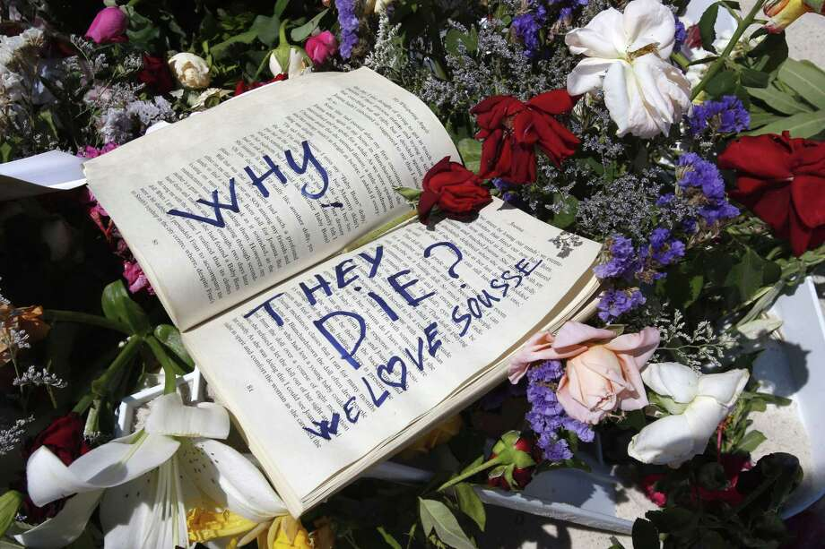 In this June 28 file photo, a book and flowers lay at the scene of the attack in Sousse, Tunisia. Tunisia's state news agency says the country's president is declaring a state of emergency more than a week after a beach attack targeting foreign tourists that killed 38 people. Photo: AP Photo  / AP