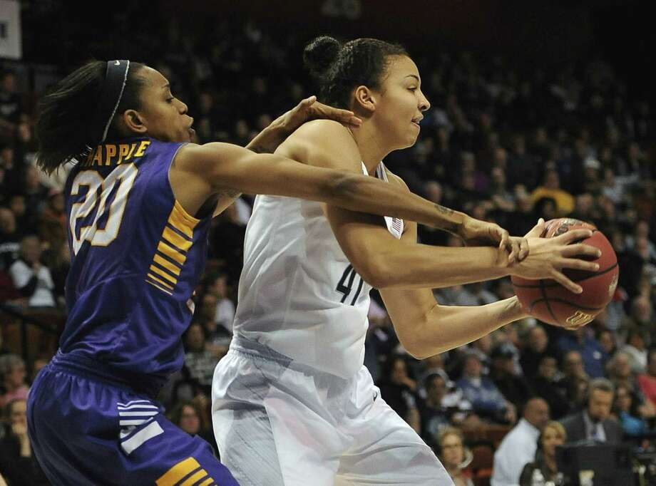Kiah Stokes, right, and the UConn women's basketball team will face USF on Monday in the AAC tournament championship game. Photo: Jessica Hill — The Associated Press  / FR125654 AP