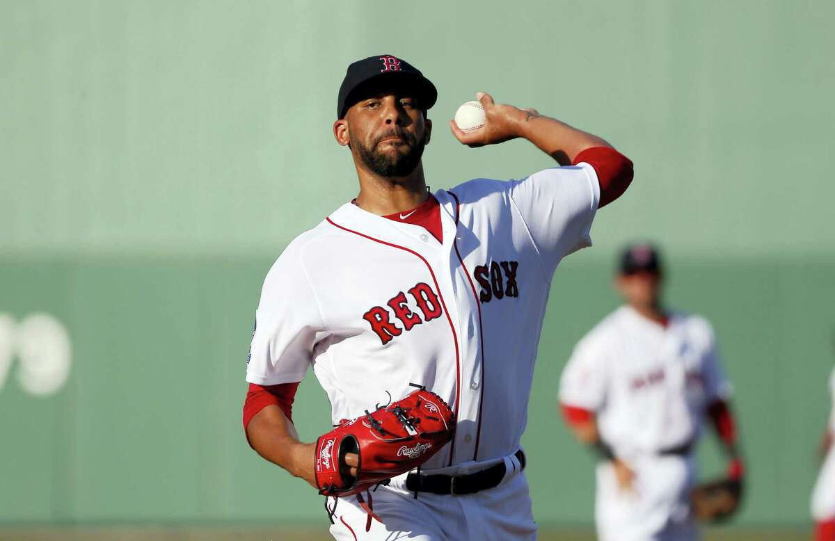 Red Sox starting pitcher David Price (24) throws warm up pitches before Tuesday's spring training game against the Yankees.