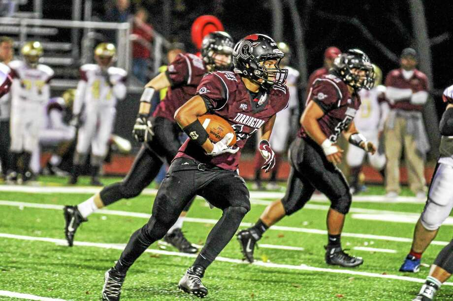 Marianne Killackey - Special to Register CitizenTorrington's Newton Frias makes an 18 yard gain in his team's win over Sacred Heart-Kaynor Tech Friday night. Photo: Journal Register Co. / 2015