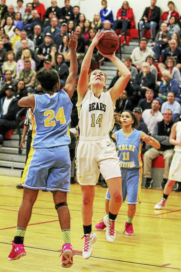 Thomaston's Morgan Sanson goes in for two of her game-high 20 points in a Class S semifinal win over Kolbe Cathedral Monday night. Photo: Marianne Killackey — The Register Citizen  / 2015