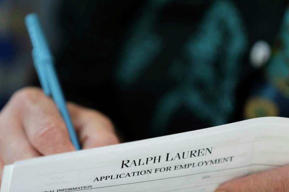 In this Tuesday, Oct. 6, 2015, photo, a job seeker fills out a job application during a job fair at Dolphin Mall in Miami. The Labor Department reports on the number of people who applied for unemployment benefits during the week ending Oct. 24 on Thursday, Oct. 29, 2015. Photo: AP Photo/Wilfredo Lee   / AP