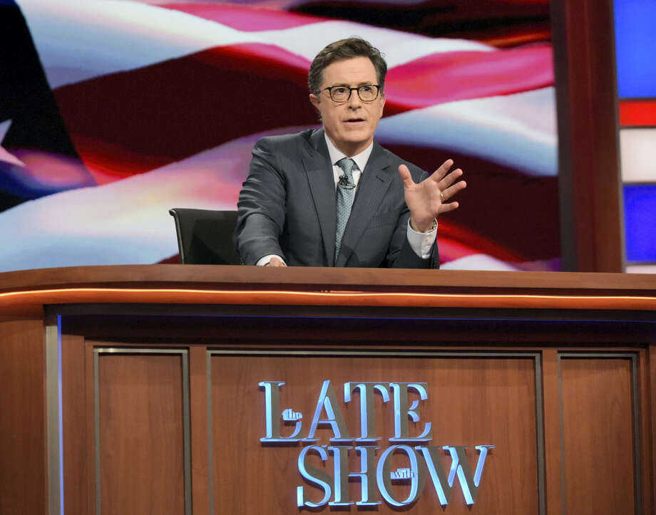 """In this July 27, 2016 photo, """"The Late Show with Stephen Colbert"""" host Stephen Colbert appears during a broadcast in New York. Lawyers representing his old show company complained to CBS after Colbert revived the character he played under his own name on """"The Colbert Report,"""" a clueless, full-of-himself cable news host. Photo: Scott Kowalchyk/CBS Via AP  / ©2016 CBS Broadcasting Inc. All Rights Reserved."""